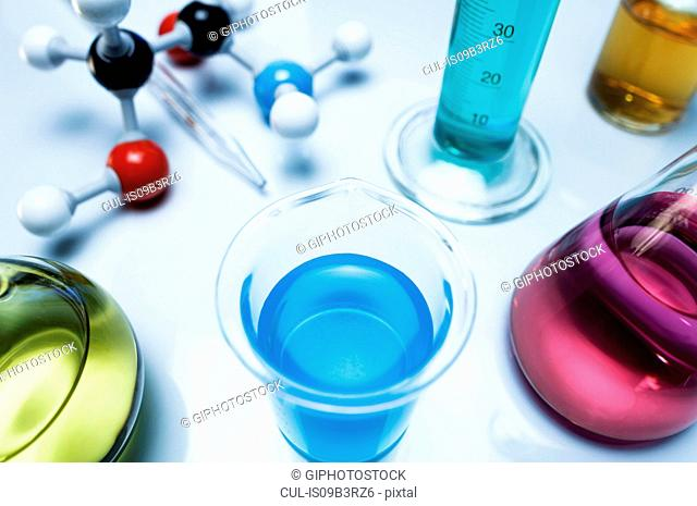 Chemistry research. Beaker containing copper sulfate (CuSO4) solution, other flasks contain transition metal salts solutions