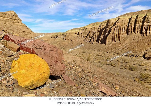 Colorful rocks exposed in large wash, Mojave Desert, CA, USA