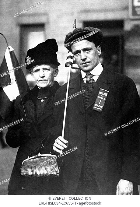 Mother escorting her son to train, who is bound for training camp. He carries a flag and wears a ribbon reading, 'Local Board for Division No
