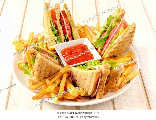 Club sandwiches and french fries