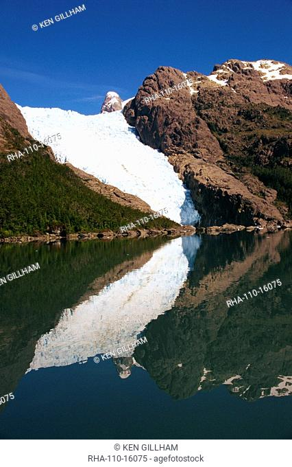 Reflections of a glacier in Chilean Fjordland, Magallanes, Chile, South America
