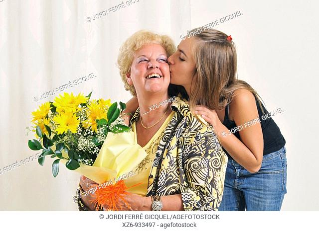 Grandmother receiving flowers from granddaughter