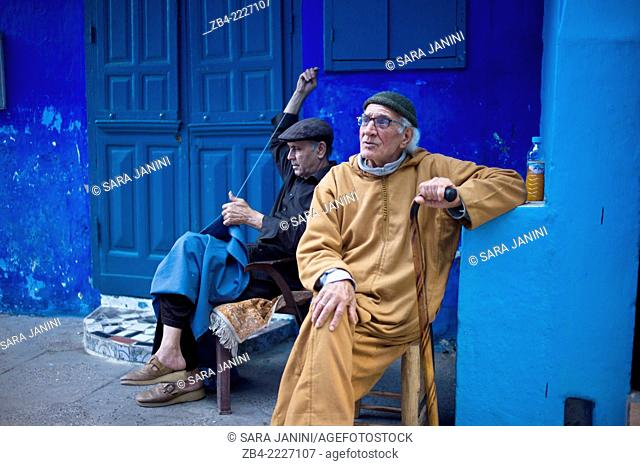 Moroccan people in a street of the Medina. Asilah, Morocco, North Africa