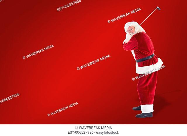 Composite image of santa claus swings his golf club