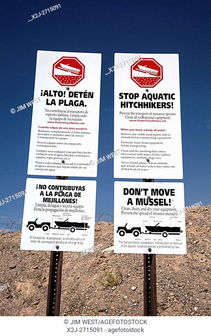 Las Vegas, Nevada - Signs at the boat launch ramp at Echo Bay on Lake Mead warn against transporting invasive mussels on boats that have been in other lakes and...