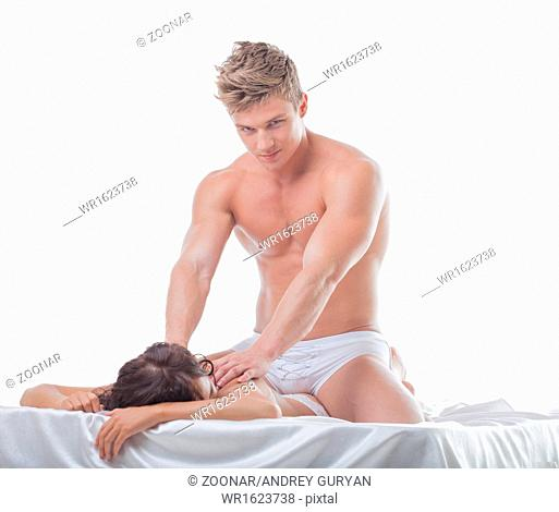 Attractive muscular guy massaging girl's back