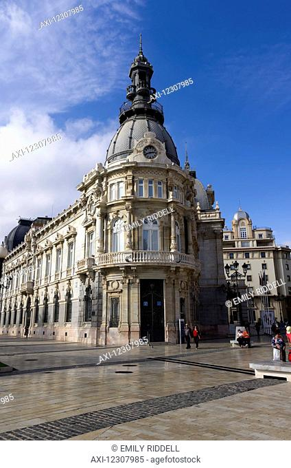 City Hall Rathaus, several tourists linger near the ornate architecture; Cartagena, Murica, Spain