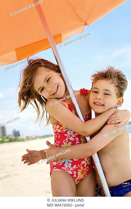 Children under a parasol, Brazil