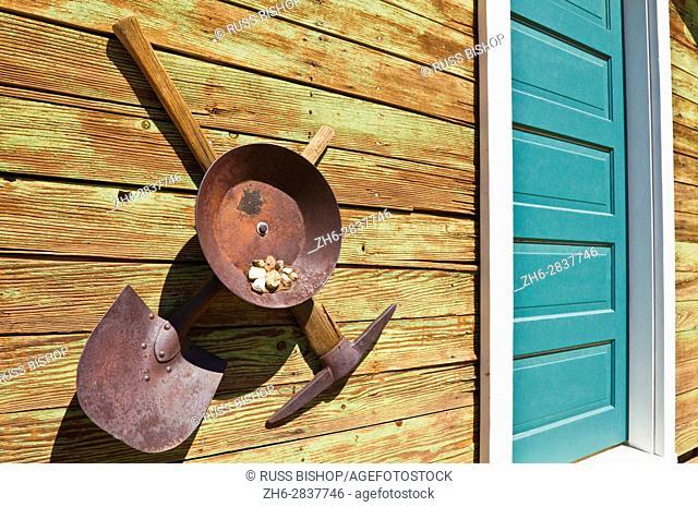 Gold miners pick, shovel and pan at the ghost town of Randsburg, California USA