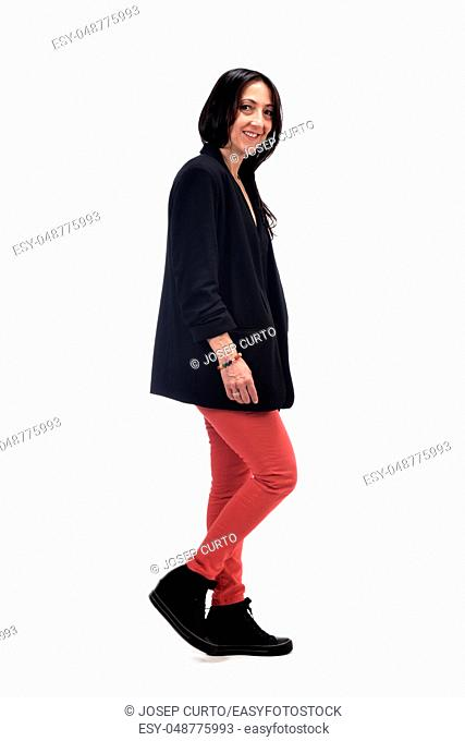 full portrait of middle aged woman walking on white