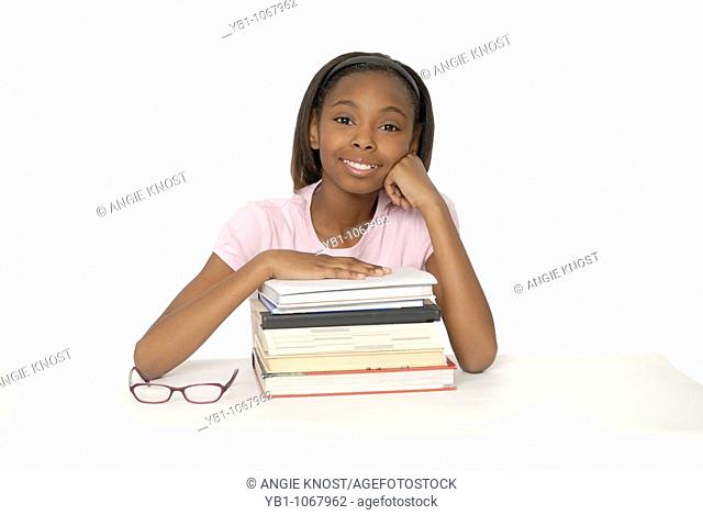 Female student with books and glasses, African ethnicity