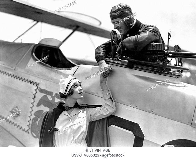 Lila Lee, Ralph Graves, on-set of the Film Flight, 1929