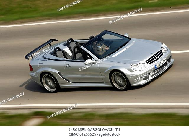 Mercedes CLK German Touring Master Championship AMG, model year 2006-, silver, driving, diagonal from the front, frontal view, side view, country road, open top