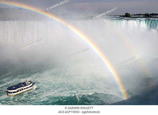 Maid of the Mist' and rainbow at the base of Horseshoe Falls viewed from Table Rock, Niagara Falls, Ontario, Canada