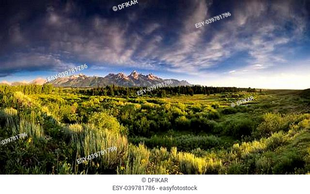 Early summer morning panorama of the Tetons as viewed from Blacktail Ponds Overlook