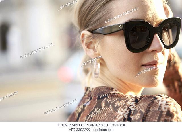 headshot of fashionable woman art street in city, in Munich, Germany