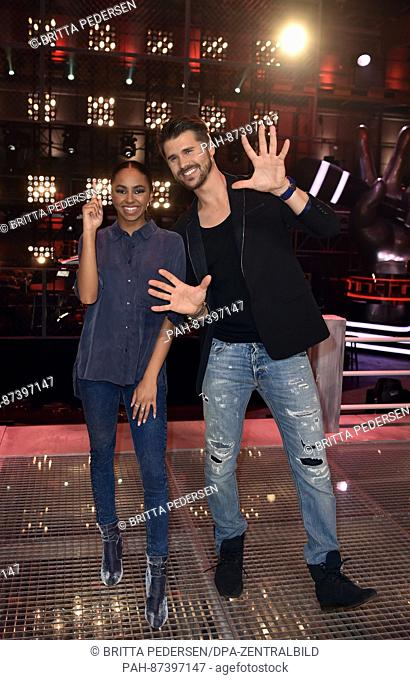 The hosts Thore Schoelermann and Debbie Schippers stand during rehearsal for the show 'The Voice Kids' in the Adlershof FilmStudios in Berlin, Germany