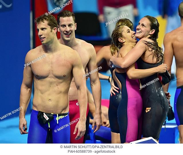 Bronze medalist's Annika Bruhn (R-L), Alexandra Wenk, Jan-Philip Glania and Hendrik Feldwehr of Germany celebrate after the Mixed 4x100m Medley Relay final of...