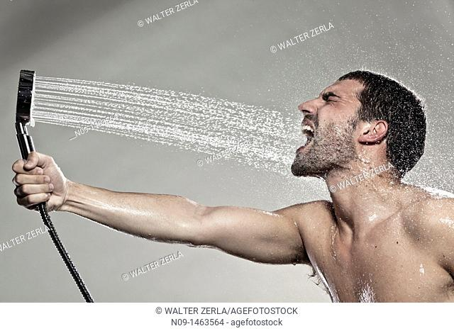 Man play with a shower