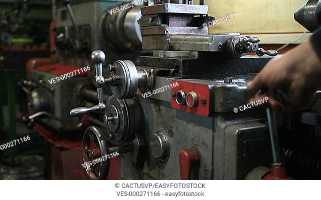 Lathe turning machine getting ready to work