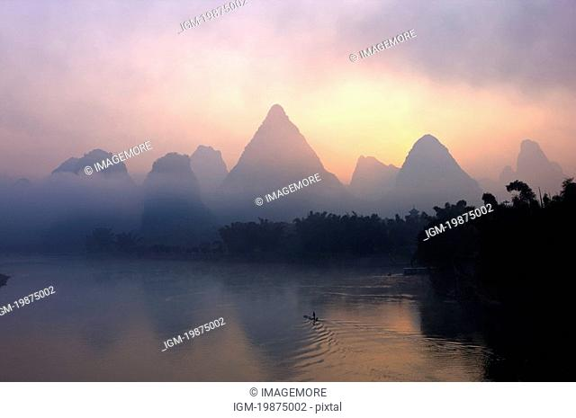 Li River with mountain at sunrise, Yangshuo, Guilin, Guangxi Province, China