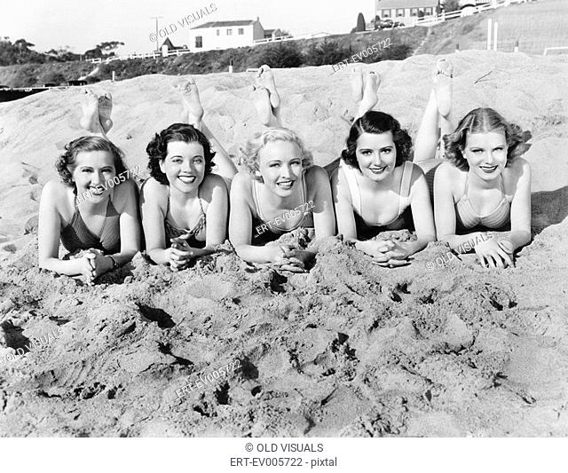 Portrait of five young women lying on the beach and smiling All persons depicted are not longer living and no estate exists Supplier warranties that there will...