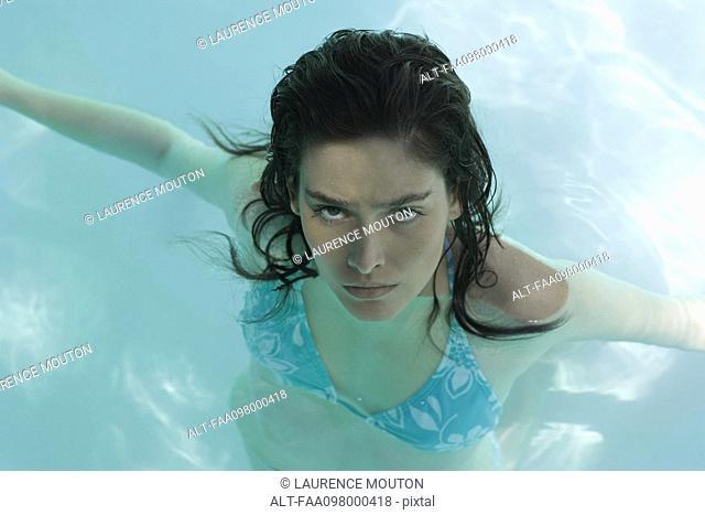 Woman in pool, portrait