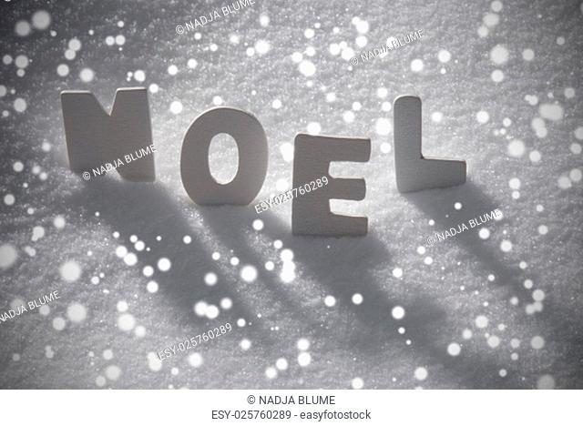 White Wooden Letters Building French Text Noel Means Christmas. Snow And Snowy Scenery With Snowfalkes. Christmas Atmosphere