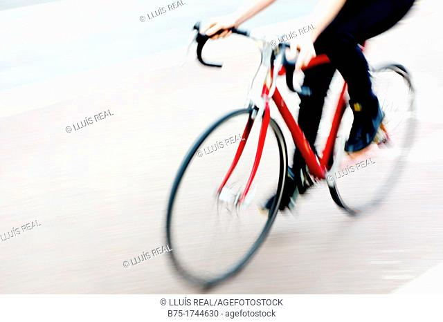 Close-up of unrecognizable woman riding bicycle