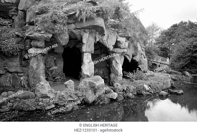 Grotto at Ascot Place, Winkfield, Berkshire, 1945. The lakeside entrance to this romantic grotto, which was built circa 1750 by Robert Turnbull