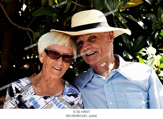 Portrait of happy senior couple in park