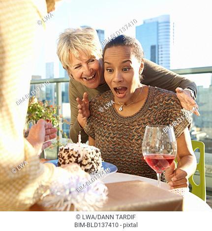 Women celebrating birthday at rooftop bar