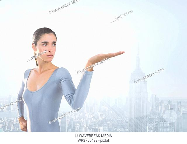 Woman with open palm hand in front of city