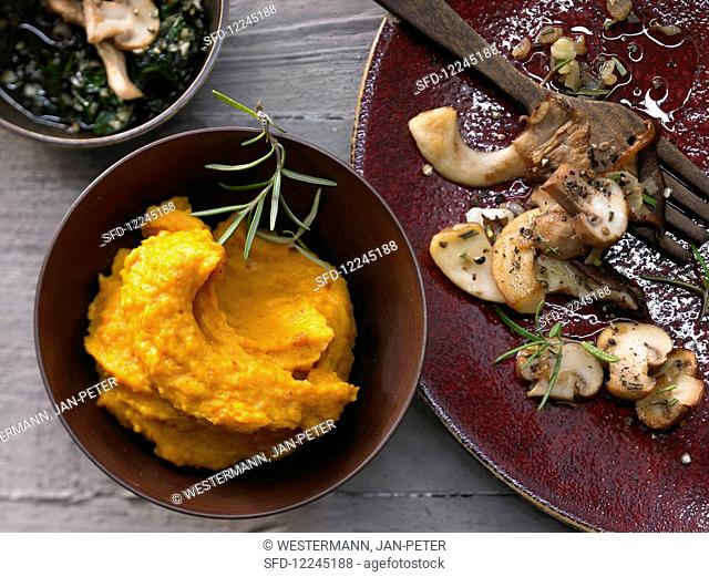 Pumpkin puree with fried mushrooms and pumpkin pesto