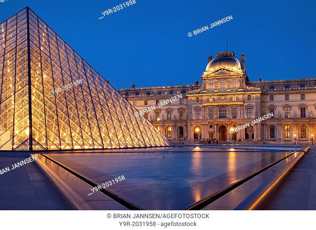 Twilight in the courtyard of Musee du Louvre, Paris France