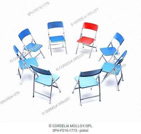 Circle of blue chairs with one red chair
