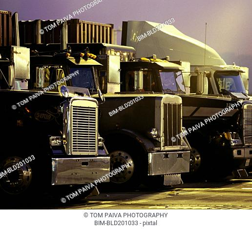 Semi-trucks in a row