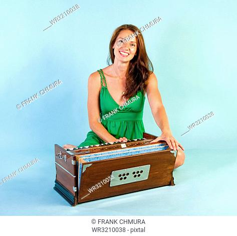 Woman Playing Harmonium Musical Instrument Smiling
