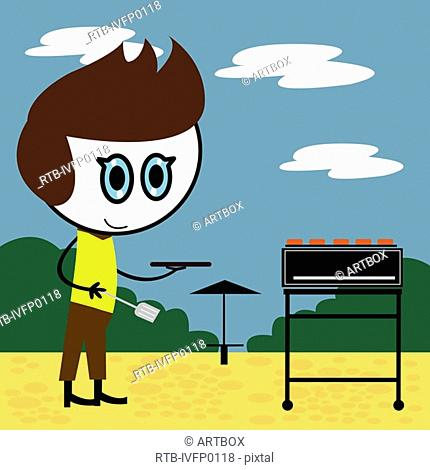Boy holding a spatula and standing near a barbecue grill