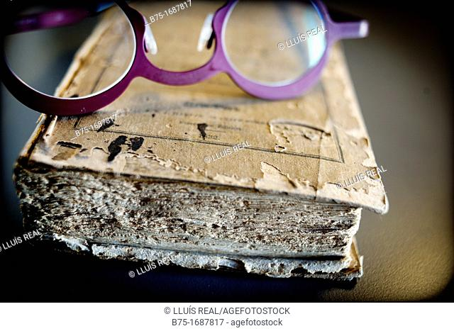 Old book with glasses for reading
