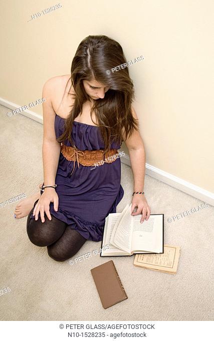 Teen girl reading a book