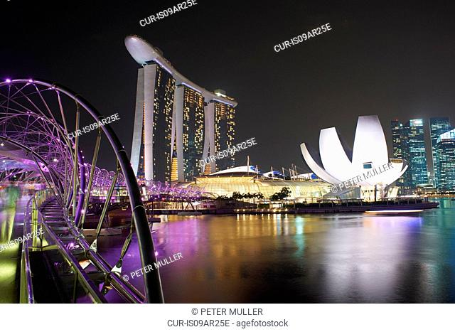 Night view of helix bridge and marina sands bay hotel, Singapore