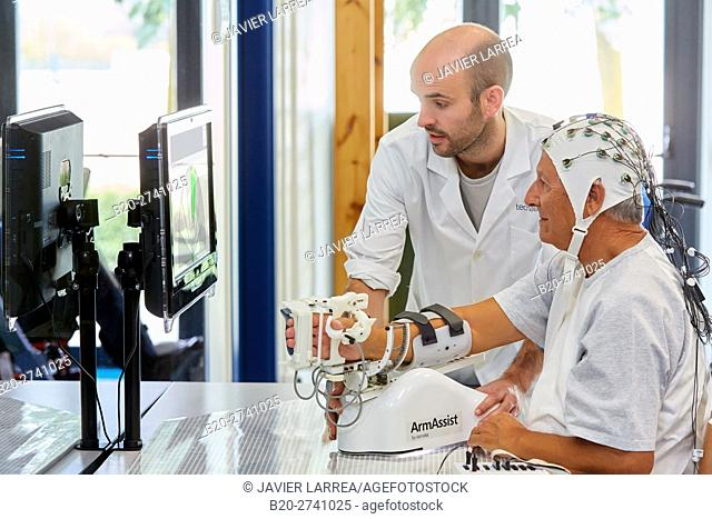 Investigator and patient with assistive robot for upper limb rehabilitation, The robot ArmAssist allows passive, assisted and active training of the arm and...