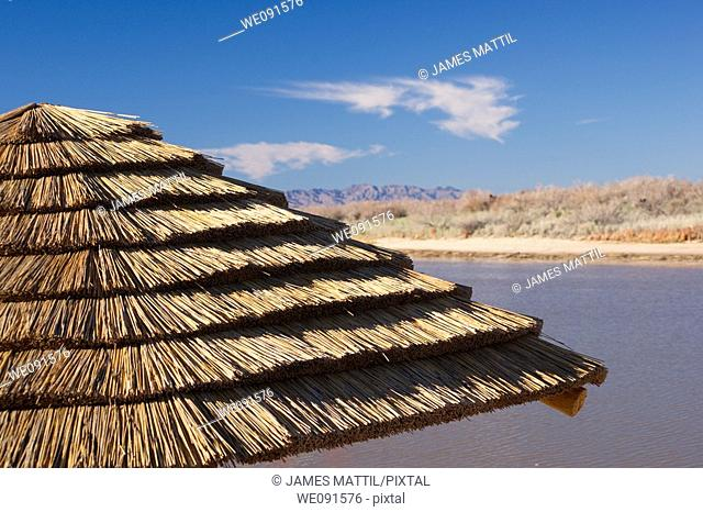 Close-up of a thatched roof palapa hut along the Colorado River in the Mojave Desert, Arizona