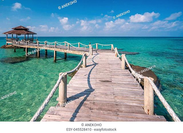 Wooded bridge to pavilion at Koh Kood island with white sand beauty beach and kayak boat. This immage can use for Thailand, travel, relax, asia, summer