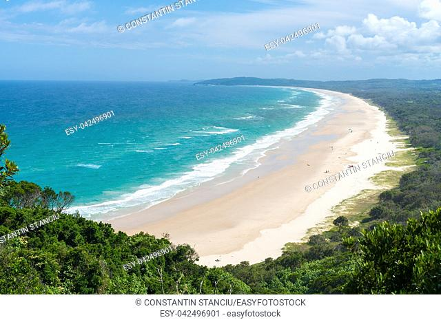 View over Tallow Beach with turquoise waters in Arakwai National Park at Byron Bay, NSW, Australia
