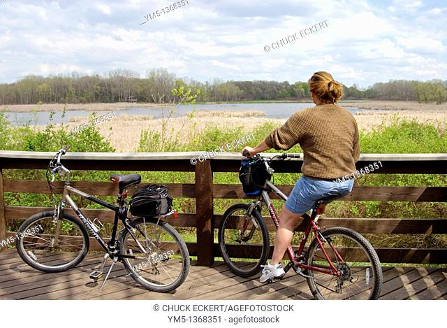 Woman resting at look out platform while on a bike ride
