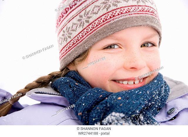 Girl in scarf and hat