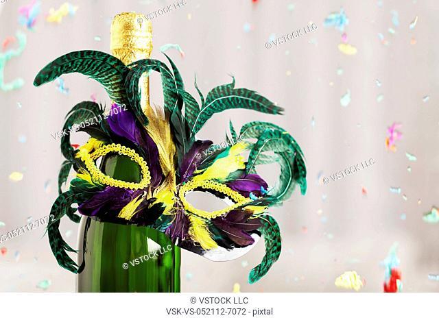 USA, Illinois, Metamora, Champagne bottle with feather decoration