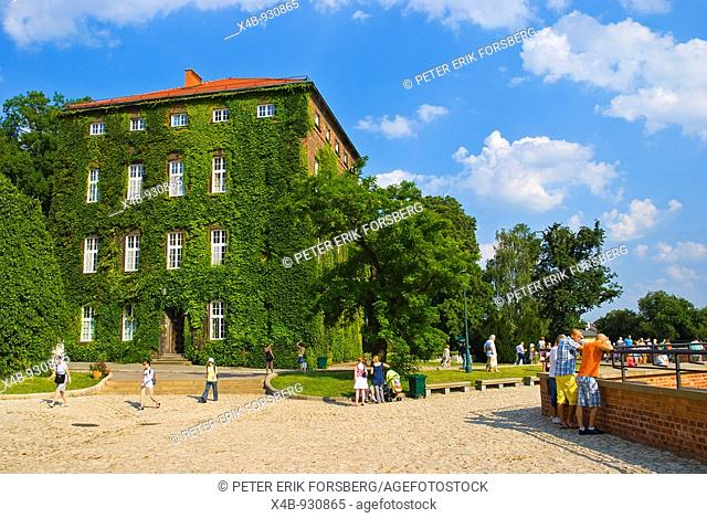 People outside Wawel castle hill walls in Krakow Poland Europe